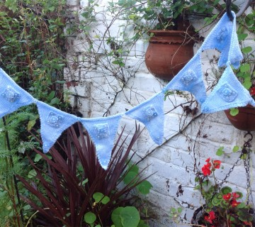 Knitted Blue Bunting With Button Detail